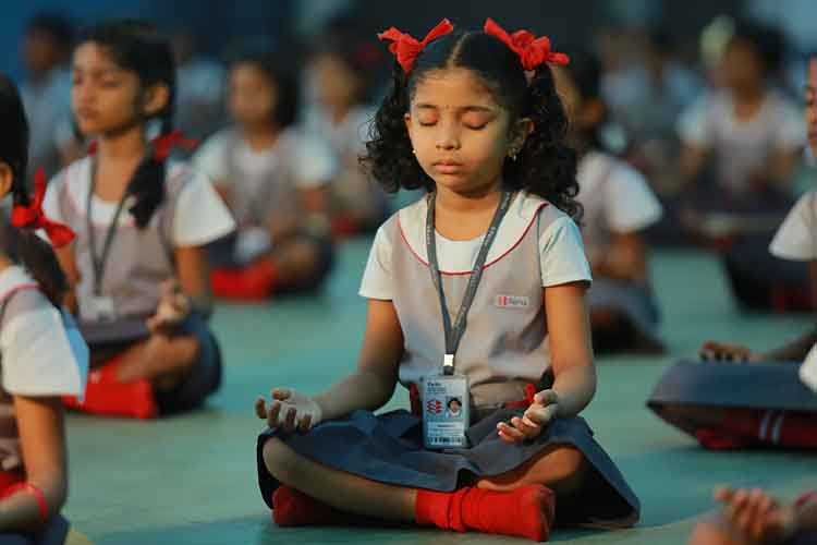 Perks school Students practicing meditation and Yoga